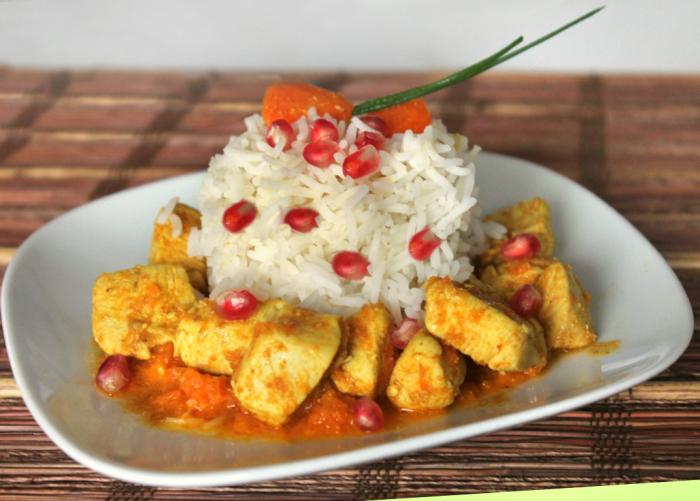 Pollo speziato con crema di carote e riso basmati alla melagrana
